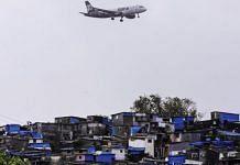 A plane flies over Mumbai slums   Dhiraj Singh/Bloomberg