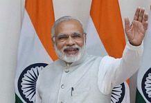 Modi waving at the audience