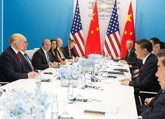 Trump and Jinping at a press conference table at the G20