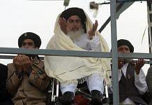 Head of the Tehreek-i-Labaik Yah Rasool Allah Pakistan (TLYRAP) religious group Khadim Hussain Rizvi (C), offers Friday prayers on a blocked flyover bridge