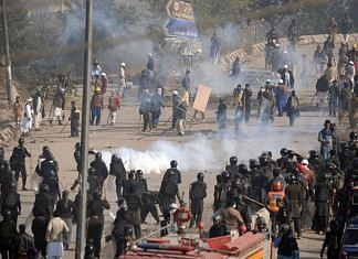 Pakistani security forces clash with protesters.