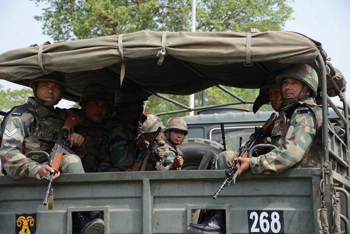 Indian Army soldiers in a truck.