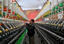 A Kashmiri labourer works inside a silk factory on the outskirts of Srinagar