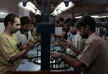 Workers polishing diamonds at a factory