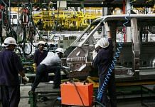 Workers in a car factory