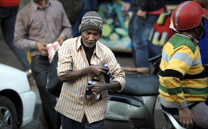 A man carrying bottles of liquor