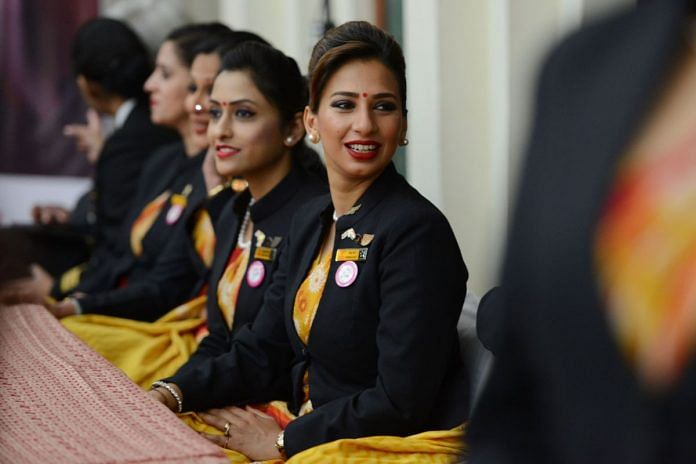 Female Indian flight attendant looking into the camera