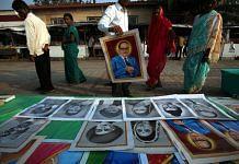 Devotees of Ambedkar buy posters in Mumbai.