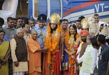 Uttar Pradesh CM Yogi Adityanath welcomes artistes dressed up as Lord Rama, Sita and Lakshman, who arrived by a chopper for Deepotsav celebrations in Ayodhya