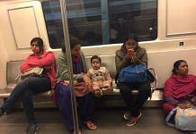 Passengers on board a Delhi Metro