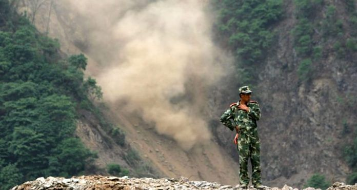A Chinese soldier on a mountain