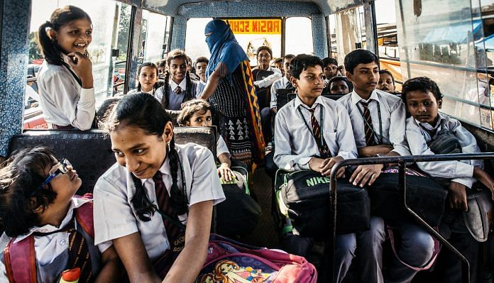 School children from an Indian school in a bus.