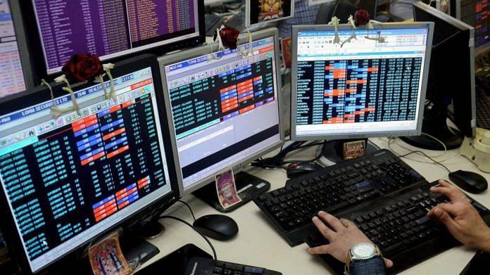 A share broker monitors market fluctuation
