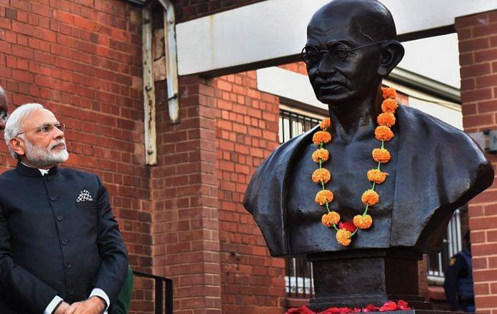 Narendra Modi with a statue of Mahatma Gandhi