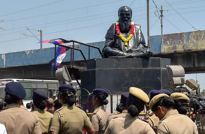Police personnel guard the statue of rationalist leader E V Ramasamy, popularly known as 'Periyar', in Chennai | PTI