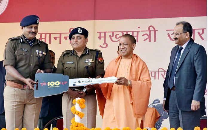 Uttar Pradesh CM Yogi Adityanath with DGP OP Singh and AGP Anand Kumar during the launch of UP 100 vehicles