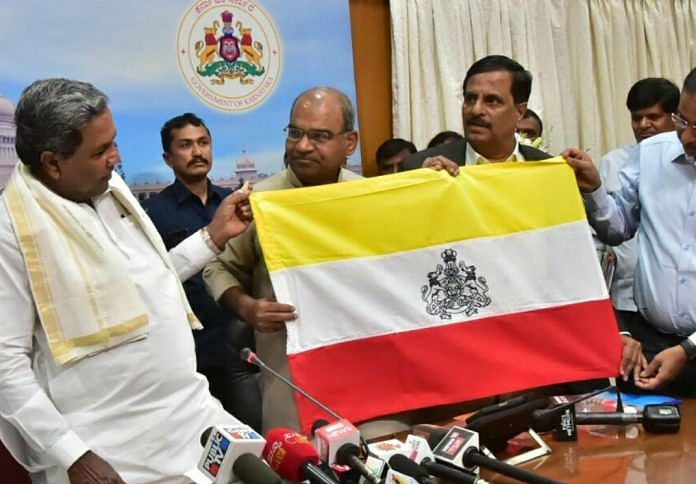 CM Siddaramaiah unveiling the state flag   Twitter