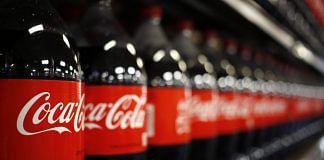 Bottles of Coca-Cola displayed for sale