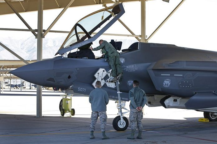 A fighter pilot climbs into the cockpit of a Lockheed Martin Corp. F-35A jet