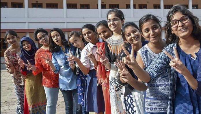 Girl students flash the victory sigh after ICSE results in Patna