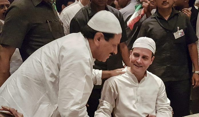 A guest greets Congress President Rahul Gandhi during his Iftar party in New Delhi | Sanjeev Chopra/PTI