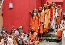 Sadhus wait in a queue for the registration for Amarnath Yatra | PTI