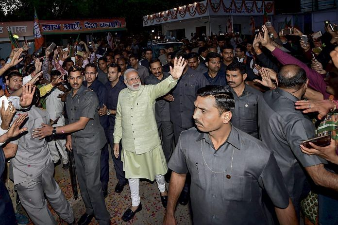File photo of Narendra Modi, surrounded by security personnel at an event in New Delhi