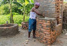 Man constructing toilet in a village in Muzaffarnagar, Bihar   Christopher Wilton-Steer/Aga Khan Development Network