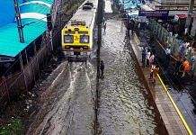 File photo of a local train on waterlogged tracks during heavy rainfall in Mumbai. (PTI Photo)