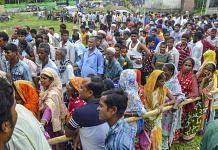 People wait to check their names on the final draft of the state's NRC | PTI