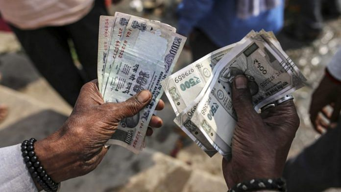 The rupee hit a record low last Thursday to cross 69 to a dollar | Dhiraj Singh/Bloomberg
