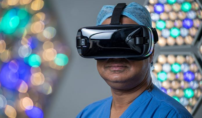 A surgeon using a VR headset at the Royal London Hospital | Chris J. Ratcliffe/Bloomberg