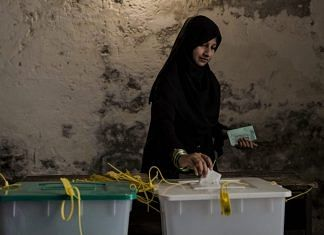 File photo of a woman casting her vote in Lahore, Pakistan | Daniel Berehulak/Getty Images