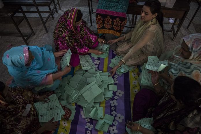 File photo of Pakistani election workers counting ballots in Lahore | Daniel Berehulak/Getty Images