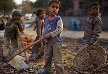 Indian children work at a construction project in New Delhi, India | Daniel Berehulak/Getty Images