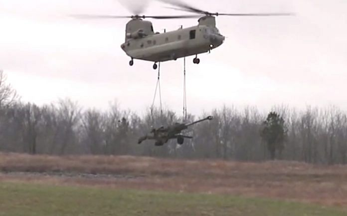 An M777 Ultra Light Howitzer underslung from a Chinook helicopter | YouTube