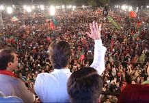 Imran Khan and his party at a rally