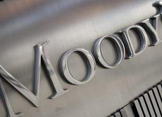 Moody's logo displayed outside its headquarters in New York | Scott Eells/Bloomberg