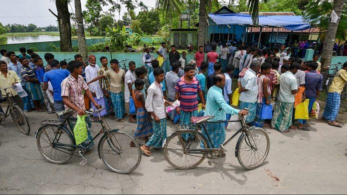 File photo: People wait to check their names on the final draft of Assam's NRC after it was released, at a NRC Seva Kendra in Nagaon in July 30, 2018. | PTI Photo