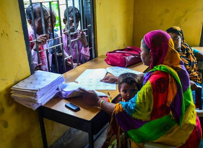People wait to check their names on the final draft NRC in Assam | PTI