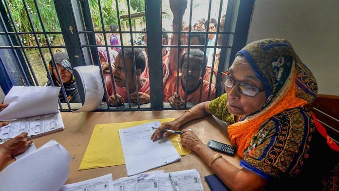 File photo | People queue to check their names on the final draft of the state's National Register of Citizens in Morigaon, July 2018 | PTI