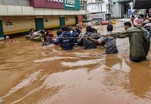 People being rescued from a flood-affected region following heavy monsoon rainfall, in Kochi | PTI