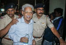 File photo of poet P Varavara Rao, arrested in connection with the Bhima Koregaon case, being produced at a court in Pune in August 2018. | PTI