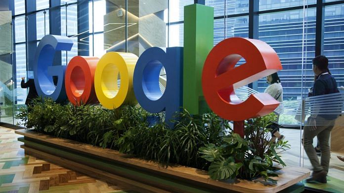 A sign featuring Google Inc.'s logo. Ore Huiying/Bloomberg