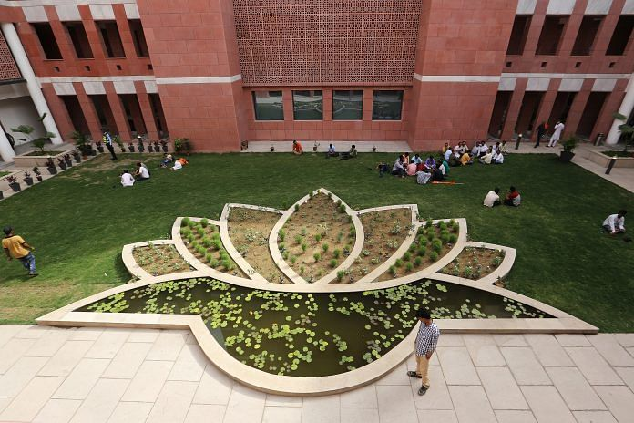 A garden feature shaped like a lotus, the emblem of the the Bharatiya Janata Party (BJP), is seen in the courtyard of the party's headquarters in New Delhi, India, on Tuesday, May 15, 2018. While the BJP has already moved into its newly-built, swanky, high-walled headquarters in New Delhi, the new office of the Congress party is still under construction due to a lack of funds, said the party leader. Congress earned one-fourth of the funds than BJP in the financial year ended March 2017. Photographer: Anindito Mukherjee/Bloomberg