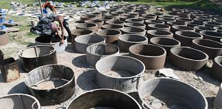 Metal moulds being made for toilet chamber rings at Cox's Bazar, Bangladesh | INDRANIL MUKHERJEE/AFP/Getty Images