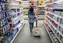 Representative image | A shopper walks through an hypermarket aisle | Dhiraj Singh | Bloomberg