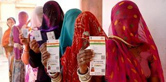 Rajasthani women show their Aadhaar cards while standing in a queue to vote   PTI