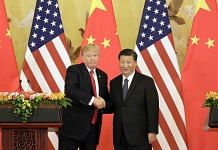 U.S. President Donald Trump, left, and Xi Jinping, China's president in China in 2017 ~ Qilai Shen/Bloomberg