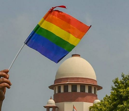 An activist waves a LGBT pride flag after the Supreme Court verdict | Kamal Kishore/PTI